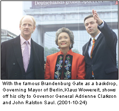 With the famous Brandenburg Gate as a backdrop, Governing Mayor of Berlin, Klaus Wowereit, shows off his city to Governor General Adrienne Clarkson and John Ralston Saul. (2001-10-24)